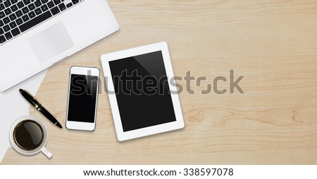 Office workplace with text space ,Wooden table with office supplies smartphone,laptop,tablet and coffee cup, top view,Web banner
