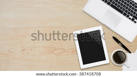 Office workplace with text space ,Wooden table with office supplies smartphone,laptop,tablet and coffee cup, top view