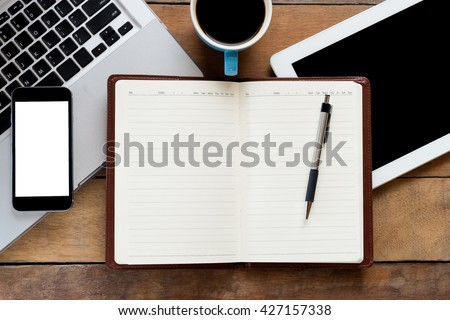 Office workspace with blank screen notebook, pen, blank screen tablet, cup of cofee, blank screen smartphone and laptop.Flat lay photo.Top view with copy space - stock photo