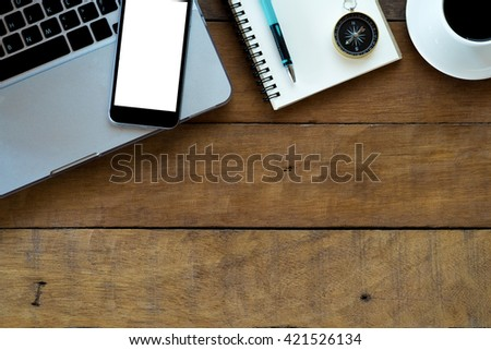 Office workspace with laptop,blank screen smartphone, coffee cup ,pencil and notebook.Flat lay photo.Top view with copy space - stock photo