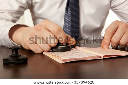 Officer of the state border guard service. Passport control. - stock photo