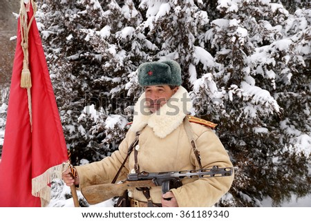 Officer, the defender of Stalingrad in winter regimentals with the Red banner