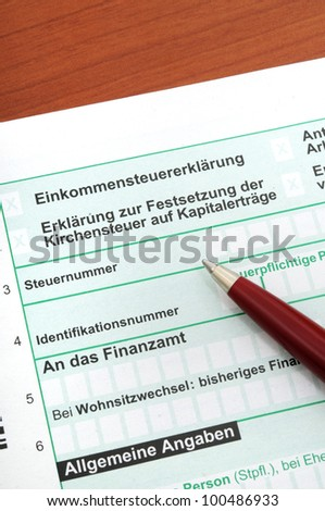 Official german tax form in front of a white background