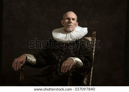 Official portrait of historical governor from the golden age. Sitting in chair. Studio shot against dark wall. - stock photo