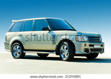 Offroad luxury car. Against the backdrop of blue sky. - stock photo
