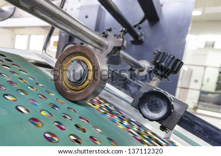 offset print machine roller with test chart color management print - stock photo
