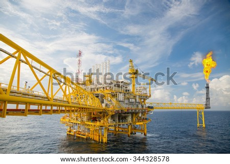 Offshore construction platform for production oil and gas, Oil and gas industry and hard work, Production platform and operation process by manual and auto function. - stock photo