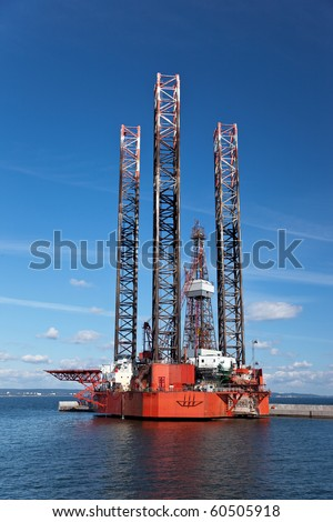 Offshore drilling on the background of blue sky. - stock photo