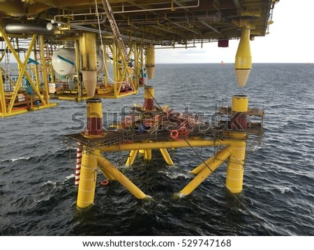 OFFSHORE EAST MALAYSIA - MAY 22, 2016: Mating of the top side and the jacket  (three legged) at offshore of South Chinese Sea.