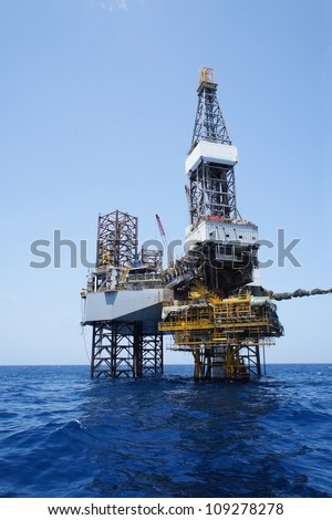 Offshore Jack Up Drilling Rig and The Production Platform for Oil and Gas Production - stock photo