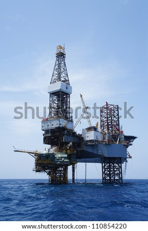 Offshore Jack Up Drilling Rig Over The Production Platform - stock photo
