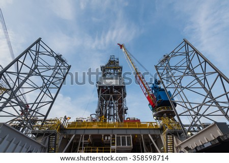 offshore jack-up oil and gas drilling rig with crane for exploration - stock photo