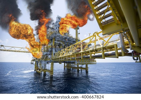 offshore oil and gas fire case or emergency case in warm picture style, firefighter operation to control fire on oil and gas production platform, offshore worst case and can't control fire - stock photo