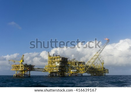 Offshore oil and rig platform in the middle of South China Sea.Construction of production process in the sea. Power energy of the world.