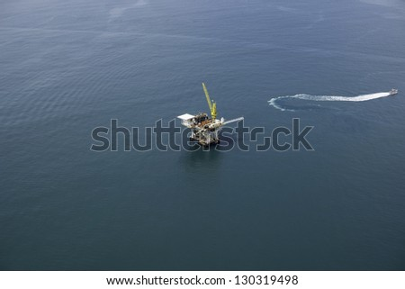 Offshore Oil Drilling Platform Aerial View - stock photo
