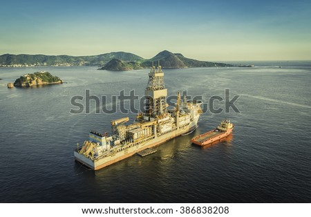 Offshore Oil drilling rig against panorama of Rio De Janeiro, Brazil - stock photo