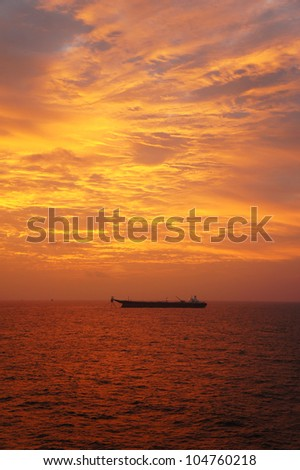 Offshore Oil Production Tanker in The Middle of The Ocean at Sunset Time - stock photo