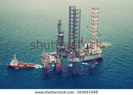 Offshore oil rig drilling platform.(color tone) - stock photo