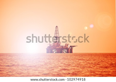 Offshore oil rig during sunset in Caspian sea - stock photo
