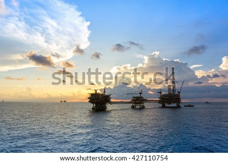 Offshore oil rig or platform during sunset at oilfield in east Malaysia - stock photo