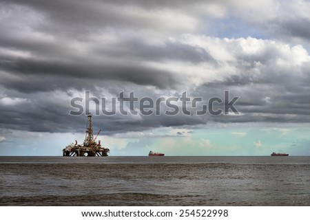 Offshore oil rig platform at sea in Trinidad and Tobago petroleum industry - stock photo