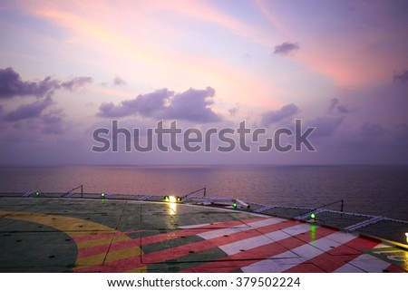 Offshore Sunset on Helideck - stock photo