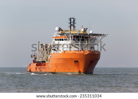 Offshore support vessel capable of trenching, laying flexible pipe, other sub sea construction, anchor handling, long tows, handling ROV operations, heavy lift operations using the A-frame etc. - stock photo