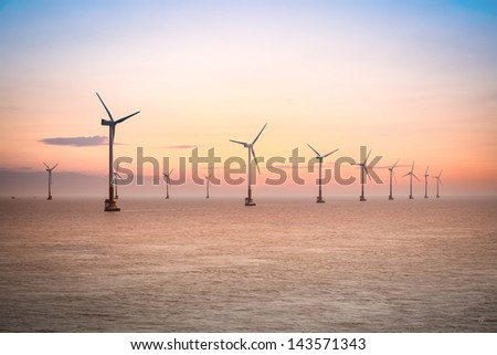 offshore wind farm at dusk in the east China sea.