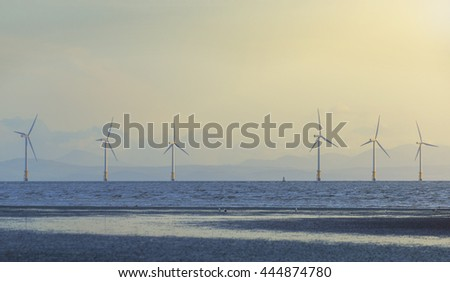 Offshore wind turbine farm, tilt shift effect, artistic blur