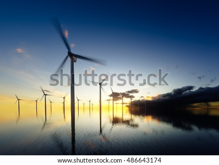 Offshore wind turbines at daybreak. 3d rendering.
