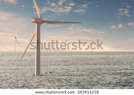 Offshore windpark for green and  natural electric power. Wind mills in water against cloudy sky - stock photo