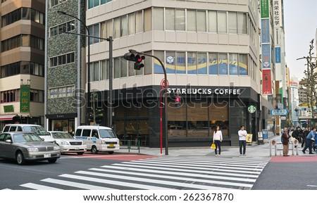 OGAWAMACHI, TOKYO - APRIL 17, 2014: Starbucks Coffe shop in the Yasukuni Street in Chiyoda ward. Around 1,000 branches in Japan.  - stock photo