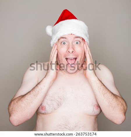 Oh my what did he get for christmas as he is one excited fat santa - stock photo