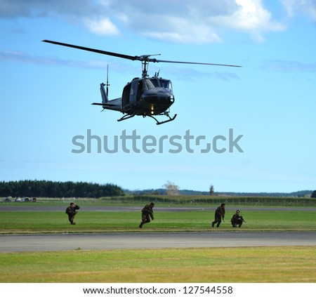 OHAKEA, NZ - MARCH 31: NZ Army demonstrating Search and Rescue using UH1H Iroquois helicopter during 75th Anniversary of New Zealand Air Force on Ohakea Airbase,New Zealand  on 31st March 2012 - stock photo