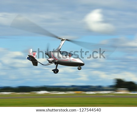 "OHAKEA, NZ - MARCH 31: The civilian plane called ""Gyro"" demonstrating its flight abilities during 75th Anniversary of Royal New Zealand Air Force on Ohakea Airbase, New Zealand on 31st March 2012. - stock photo"