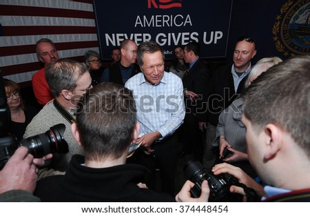 Ohio Governor John Kasich meets voters at the Stone Church in Newmarket, New Hampshire, on January 17, 2016, during the New Hampshire presidential primary - stock photo
