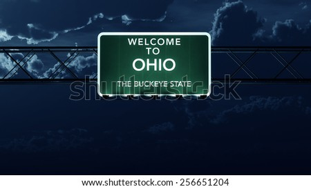 Ohio USA State Welcome to Interstate Highway Road Sign at Night - stock photo