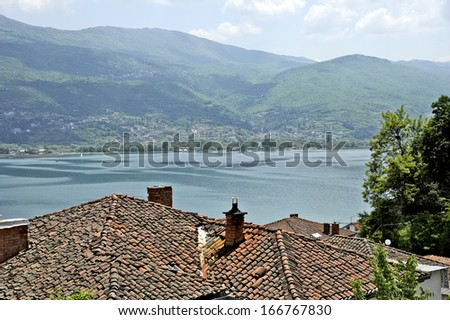 OHRID, MACEDONIA, MAY 18, 2011. A view of lake Ohrid over the top of the roofs of the town Ohrid. - stock photo
