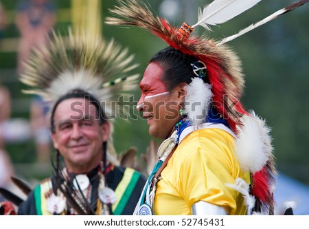 OHSWEKEN, ONTARIO, CANADA - JULY 27: Traditional dancers waiting for their dance to start during the Grand River Champion of Champions Powwow July 27, 2008 in Ohsweken, Ontario, Canada. - stock photo