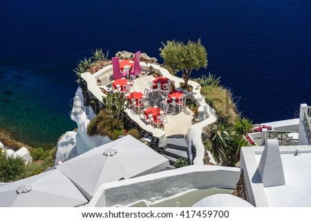Oia luxury outdoor cafe  - stock photo