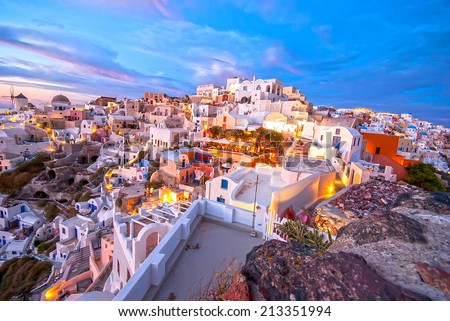 Oia Santorini Greece famous with beautiful romantic sunsets - stock photo