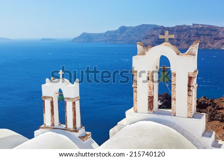 Oia town on Santorini island, Greece. Traditional bells and crosses over the Caldera, Aegean sea - stock photo