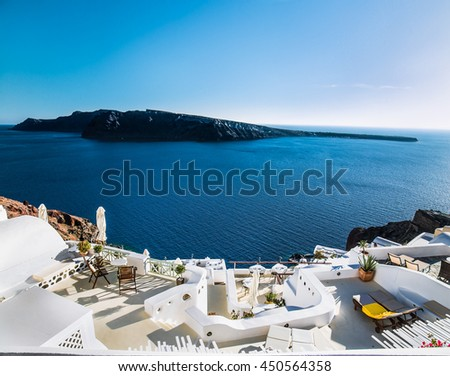 Oia village at suny day on Santorini island, Greece.