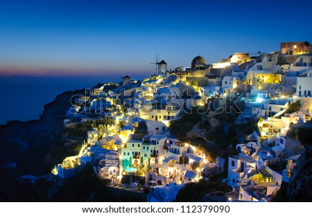 Oia village in Santorini at in the evening, Greece - stock photo