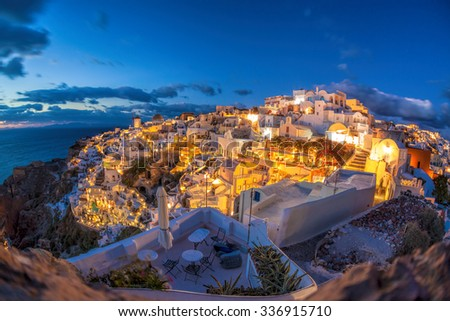 Oia village in the evening on Santorini island, Greece - stock photo