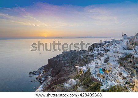 Oia village lights at night with dusk sky colors Santorini, Greece - Oia at sunset, Santorini, Cyclades, Greece, Building lit up after sunset in Oia, Santorini, Greece - stock photo