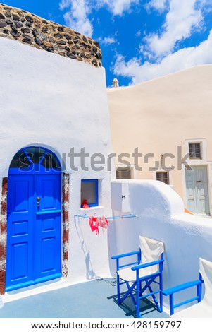 OIA VILLAGE, SANTORINI ISLAND - MAY 24, 2016: Swimsuit drying on sunny terrace of typical Greek house in Oia town on island of Santorini, Cyclades, Greece.