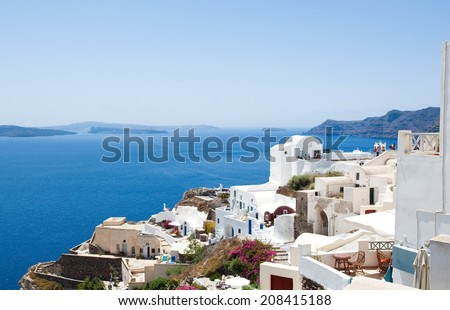 Oia with typical white and blue painted houses on the island of Santorini(Thera), Greece. - stock photo