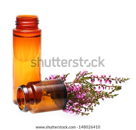 Oil and flowers isolated on white background.