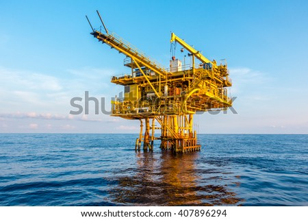 Oil and gas drilling platform industrial in the gulf or the sea, The world energy industrial oil and gas, Offshore oil and gas industrial rig construction. - stock photo